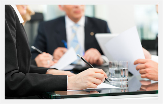 Attorneys & Client in Meeting